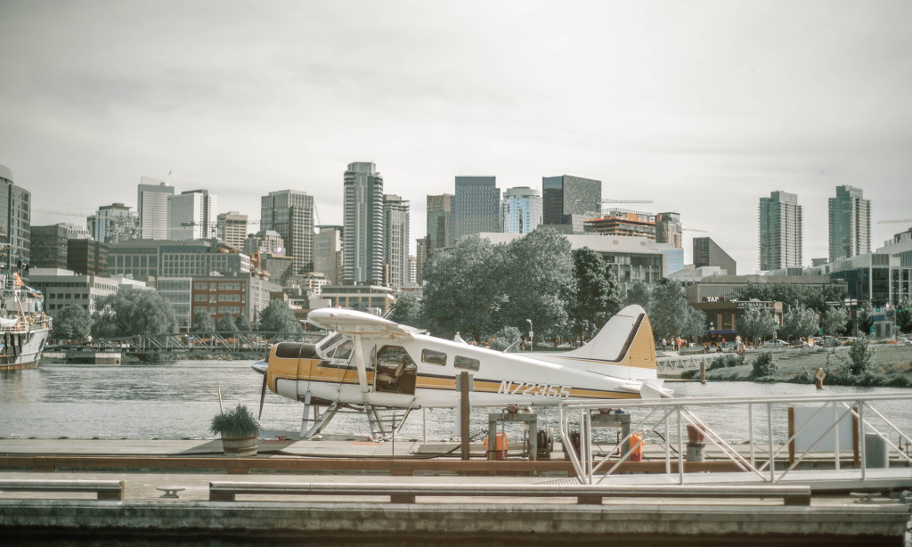 Sea plane docked with Seattle skyline in the background