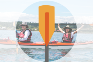 Icon of orange kayak paddle over faded image of two women smiling and posing in a kayak