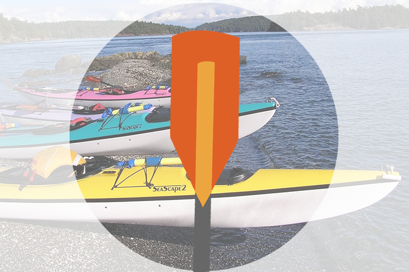 Icon of orange kayak paddle over faded image of three colorful kayaks parked on pebble beach next to water