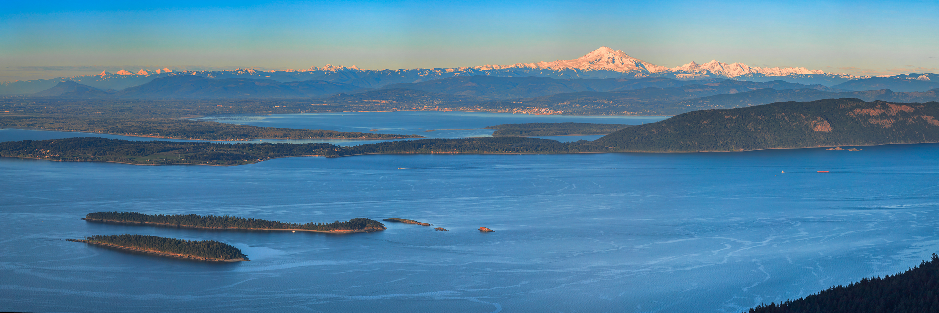 From above image of San Juan Islands, the sea and mountain range in distance